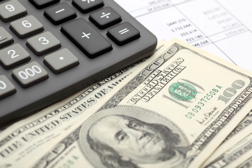 Counting your cash and keeping track of your budget with a calculator is a great habit.