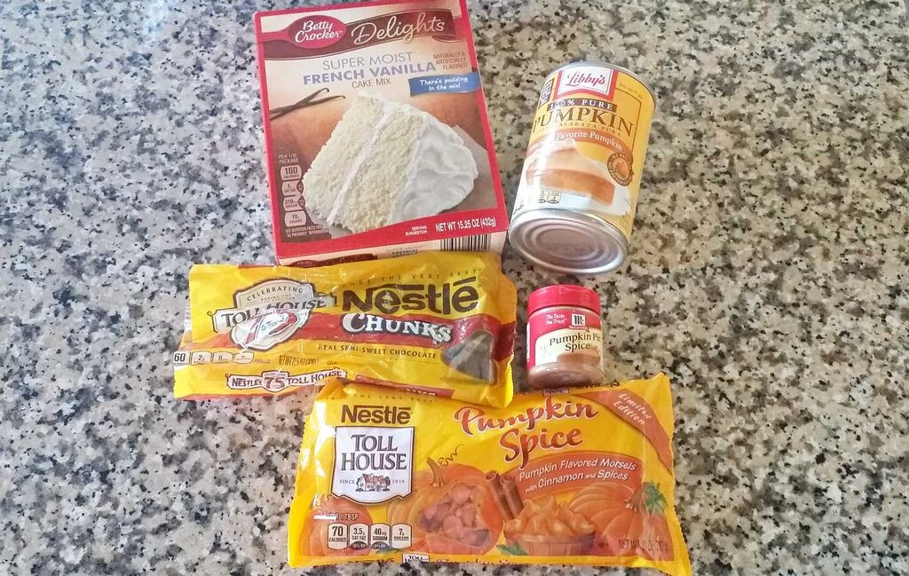 Assemble your ingredients: Vanilla cake mix, pumpkin pure, pumpkin pie spice, pumpkin spice morsels and chocolate chunks.