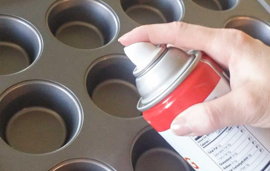 Spray muffin tins with nonstick cooking spray.