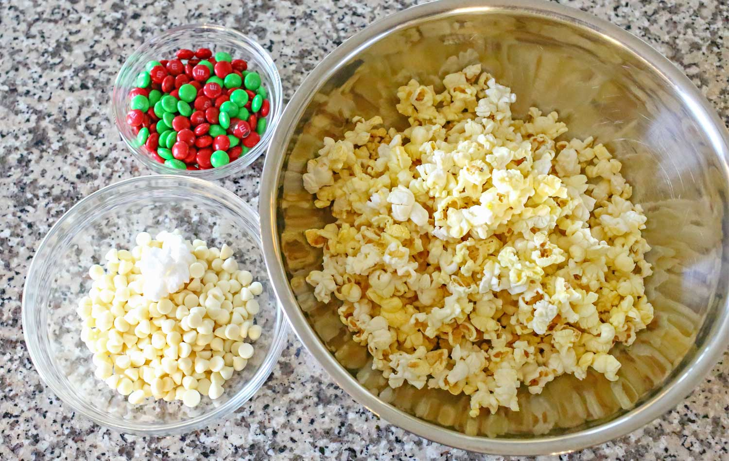 Assemble the ingredients for this yummy and addictive white chocolate holiday popcorn.