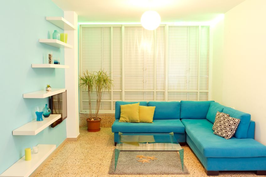 Love modern, clean lines like this blue living room? A small house looks great with fun modern furniture.