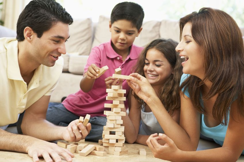 Living in a smaller home gives you more time to bond with your family, like enjoying Jenga on game night. It's a matter of finding the right balance.