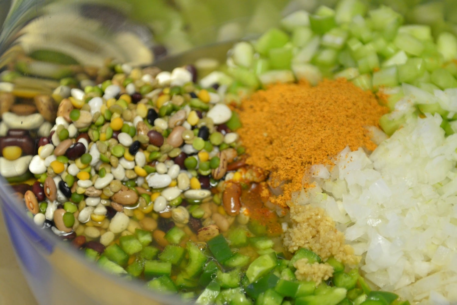 Combine the beans, peppers, onion, celery and seasonings in a bowl.