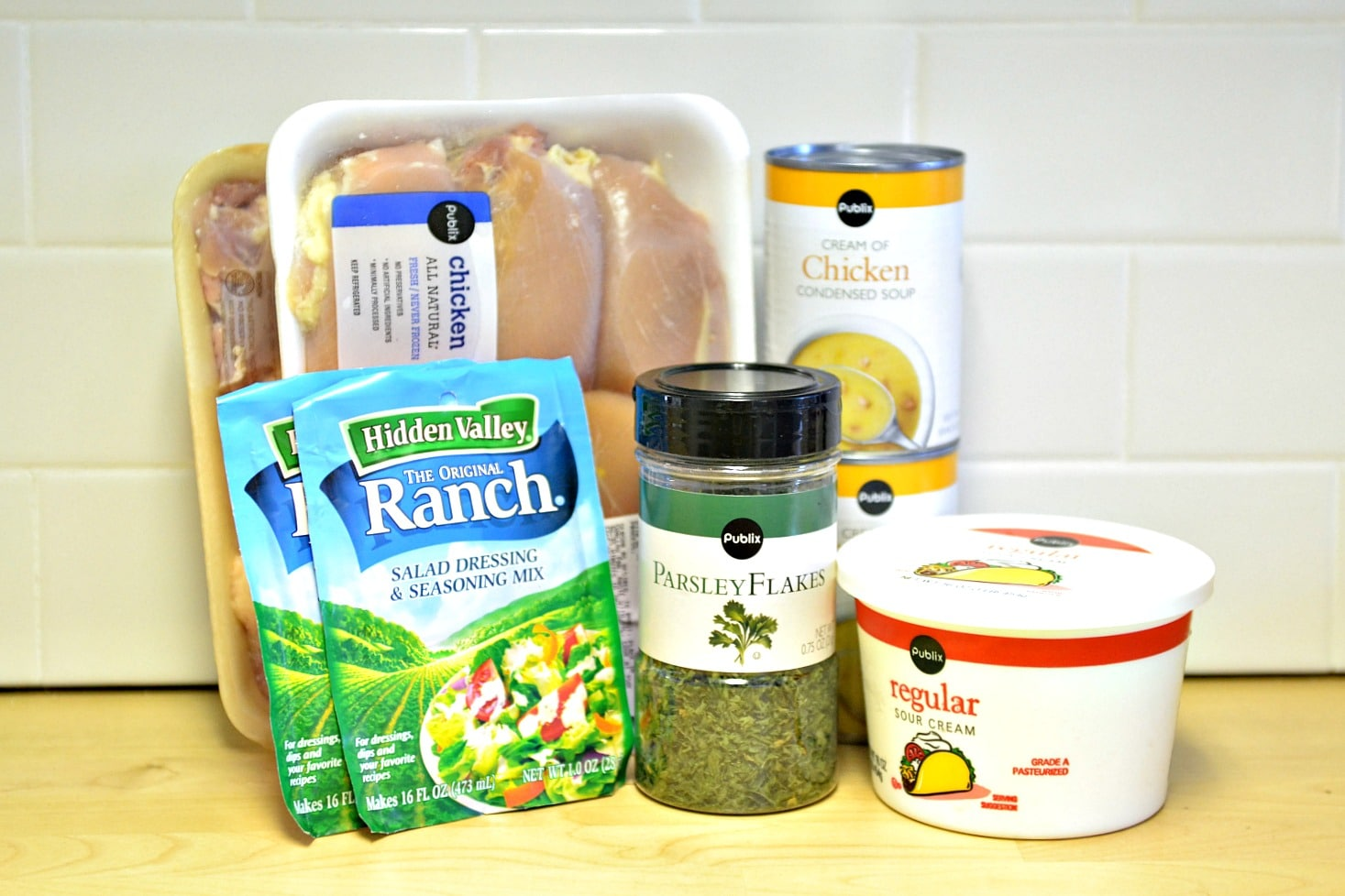 Ingredients needed for this crockpot creamy ranch chicken - you need chicken thighs, ranch seasoning, parsley, cream of chicken soup, and sour cream.