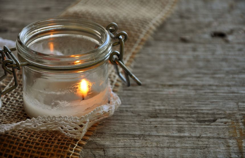 Use an empty mason jar to make your own candle.