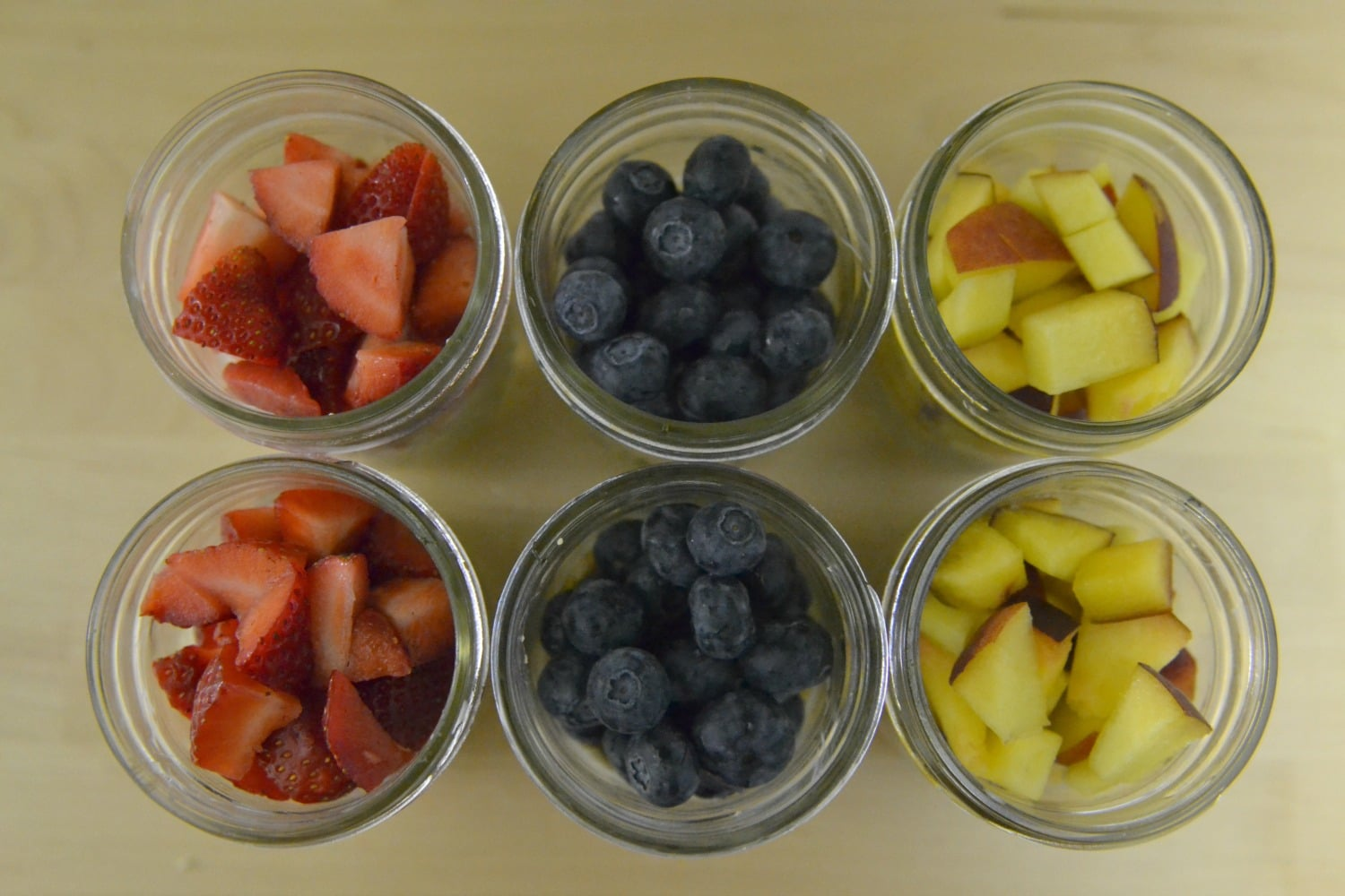 Top each jar with desired fruit and cover with mason jar lid