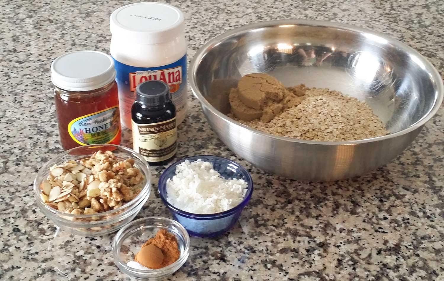 Assemble your ingredients for the vanilla almond granola: Oats, almonds, walnuts, shredded coconut, brown sugar, salt, cinnamon, coconut oil, honey and vanilla bean paste.