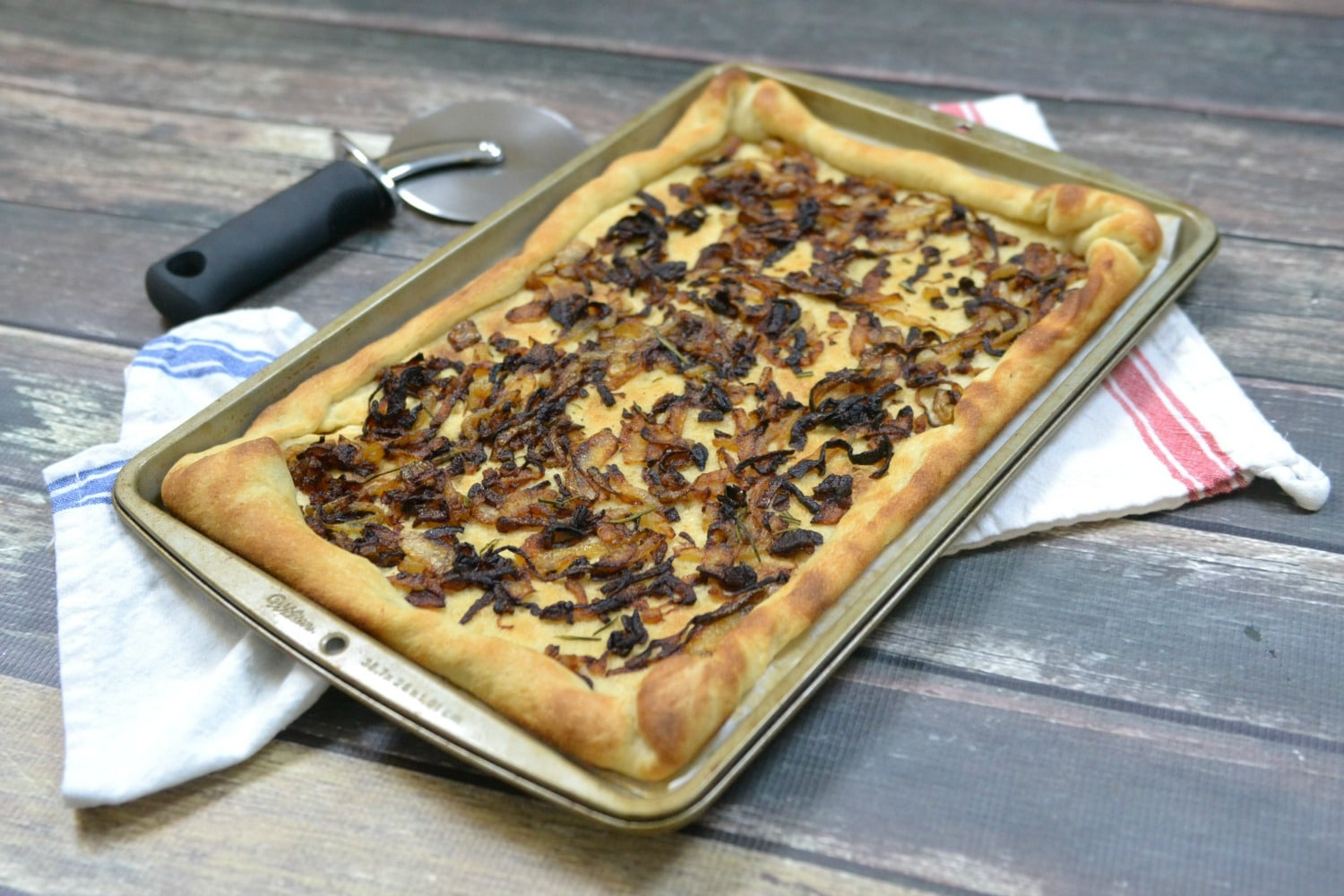 Bake caramelized onion flatbread until lightly browned.