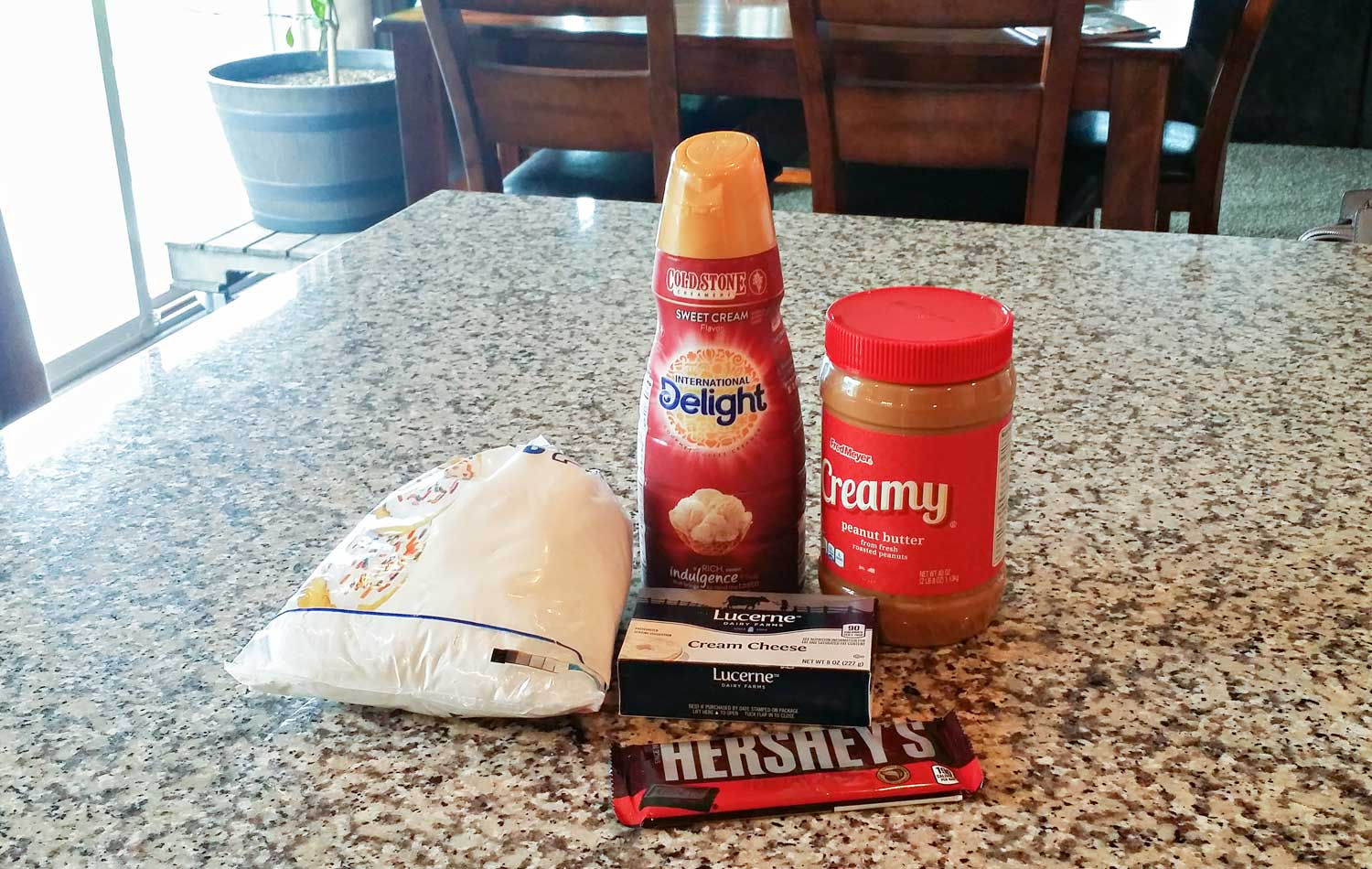 Assemble all your ingredients: peanut butter, cream cheese, confectioners sugar, sweet cream coffee creamer and chopped chocolate pieces.
