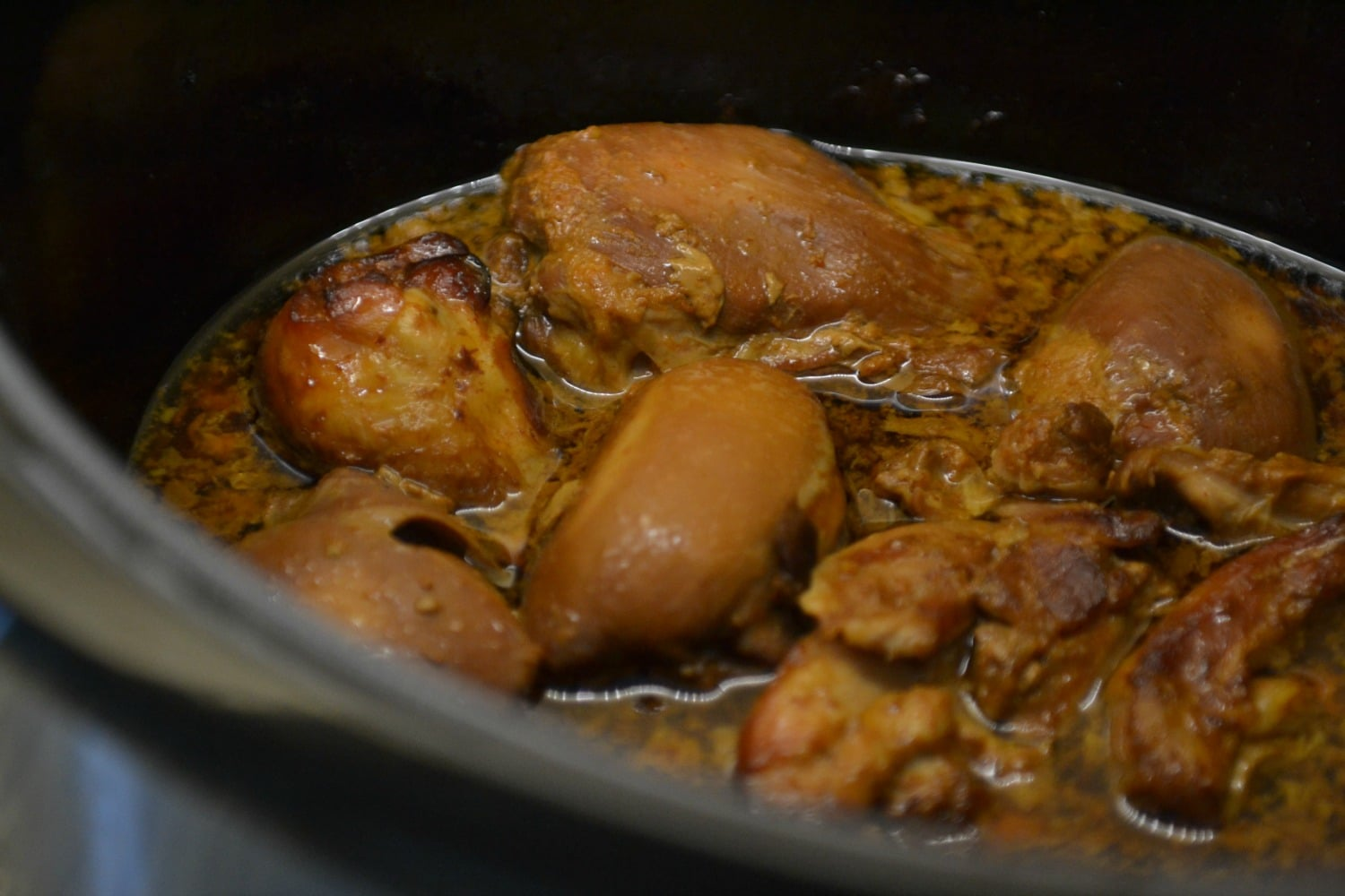 Place marinated chicken into slow cooker.