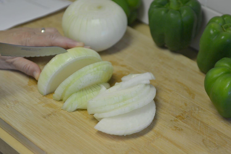 Slice the onion on a cutting board.
