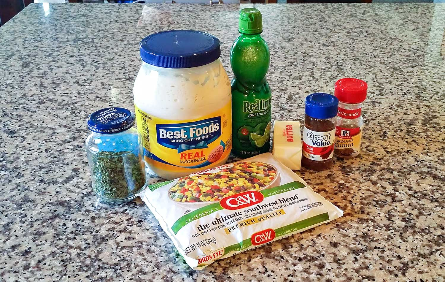 Assemble your ingredients: Ultimate Southwest Blend frozen pack (contains corn, black beans, chilies, red peppers & roasted onions), butter, chili powder, cumin, mayonnaise, lime juice, chives, salt and pepper