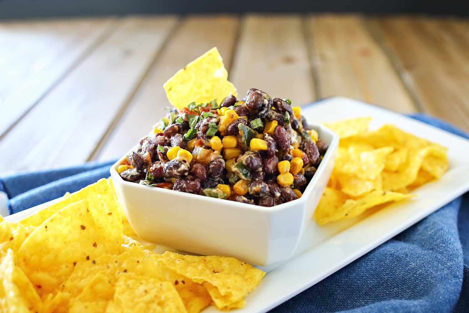 Transfer corn and black bean salsa to serving bowl, garnish with chives and serve with tortilla chips.