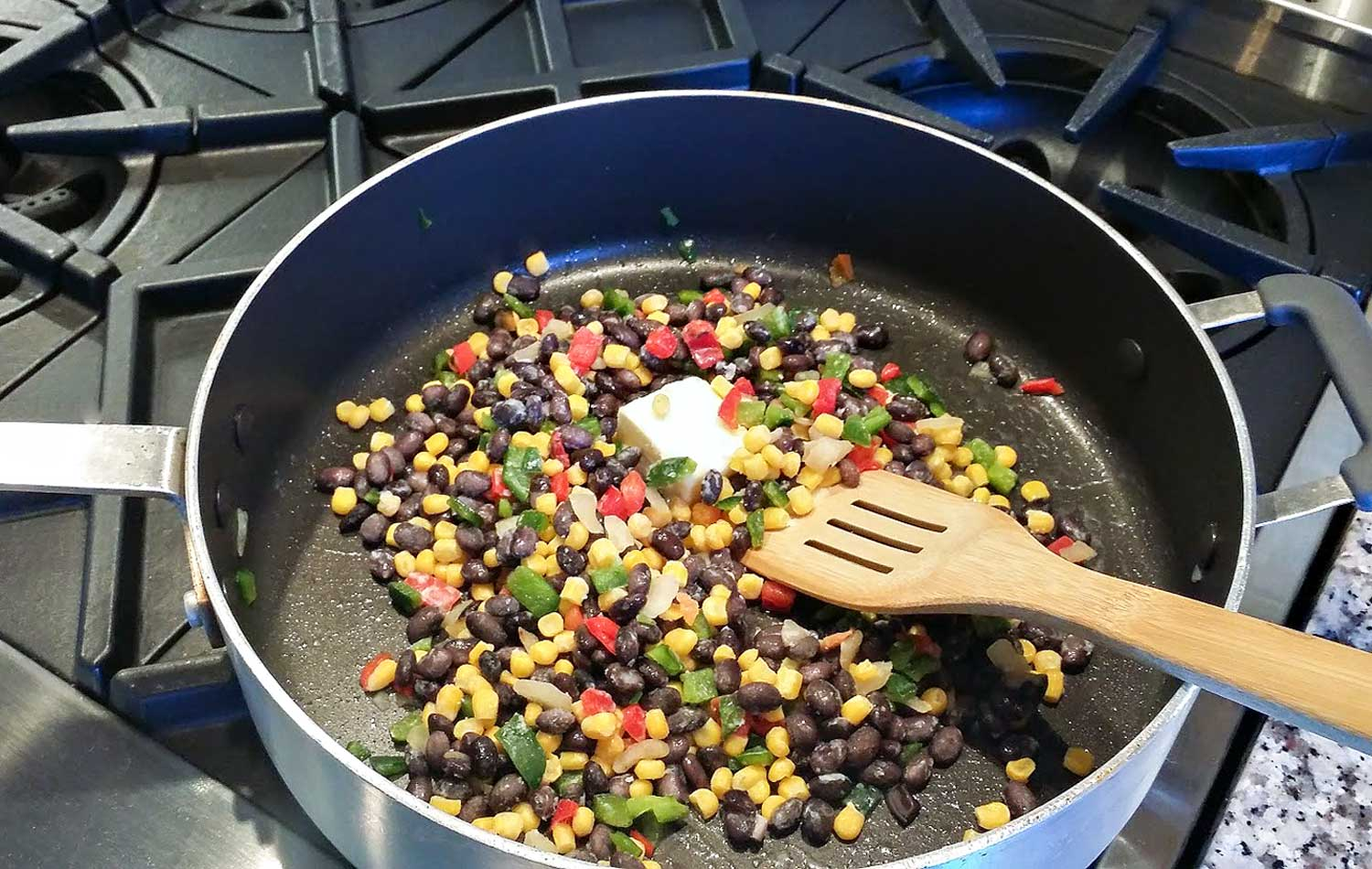 Combine corn blend, butter and seasonings in a large skillet and saute.