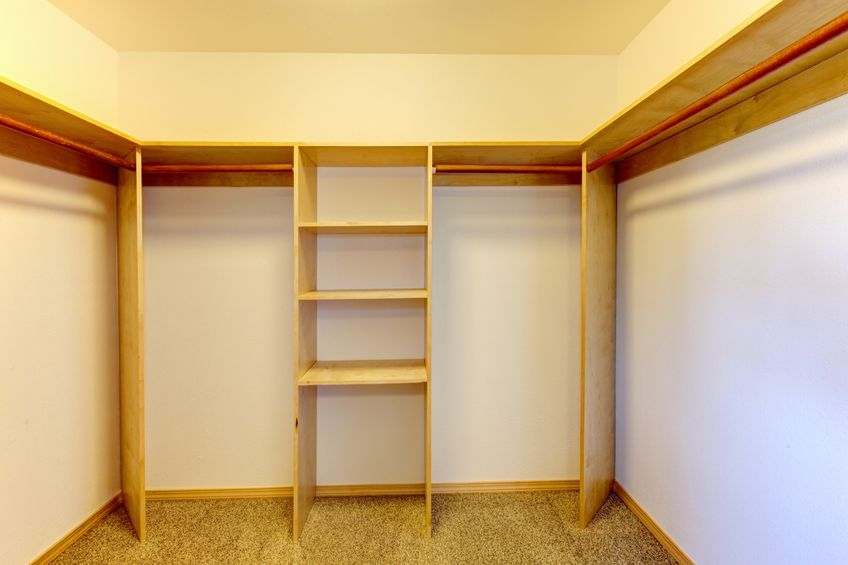 A large empty closet with a lot of empty space. Assess your space for organizing.