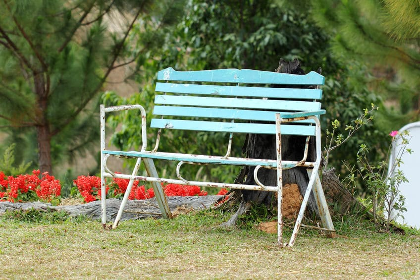 Consider re-purposing your old lawn furniture with spray paint to brighten up your backyard.