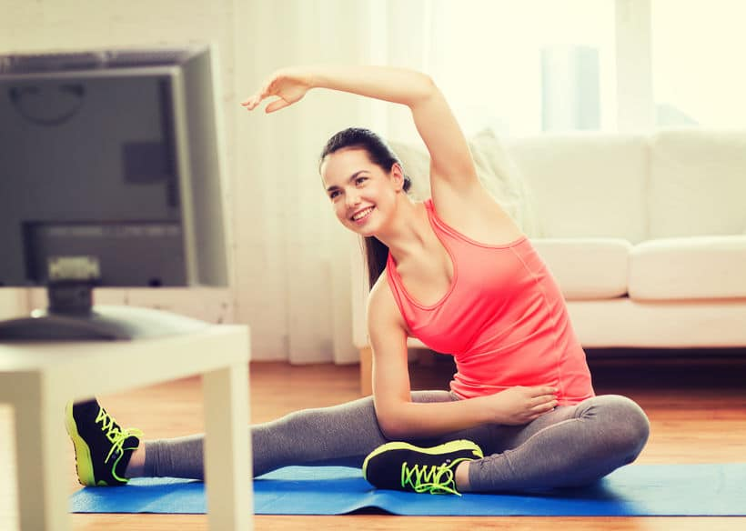 Exercising at home with the TV is an easy way to get fitness in.