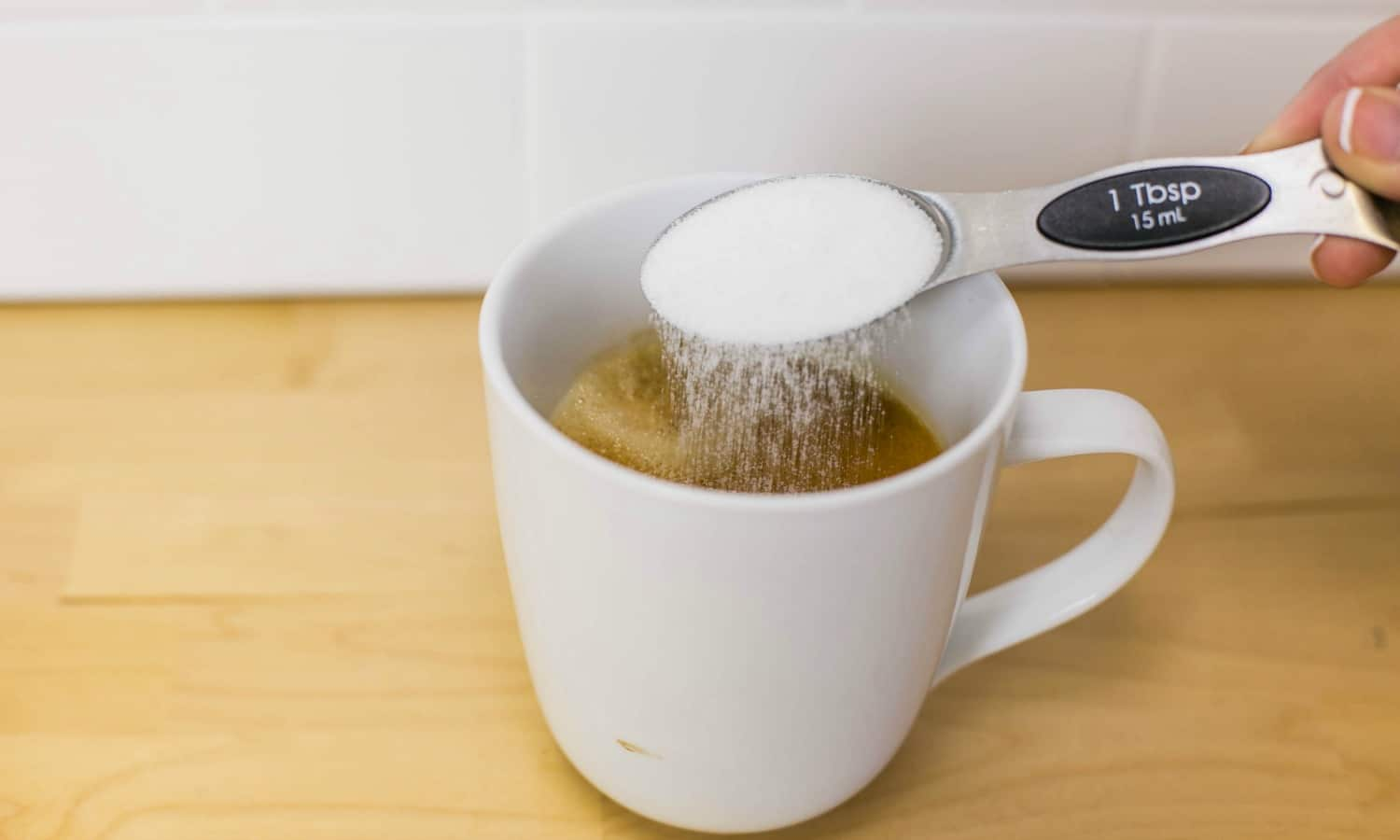 Dissolve the sugar in the coffee.