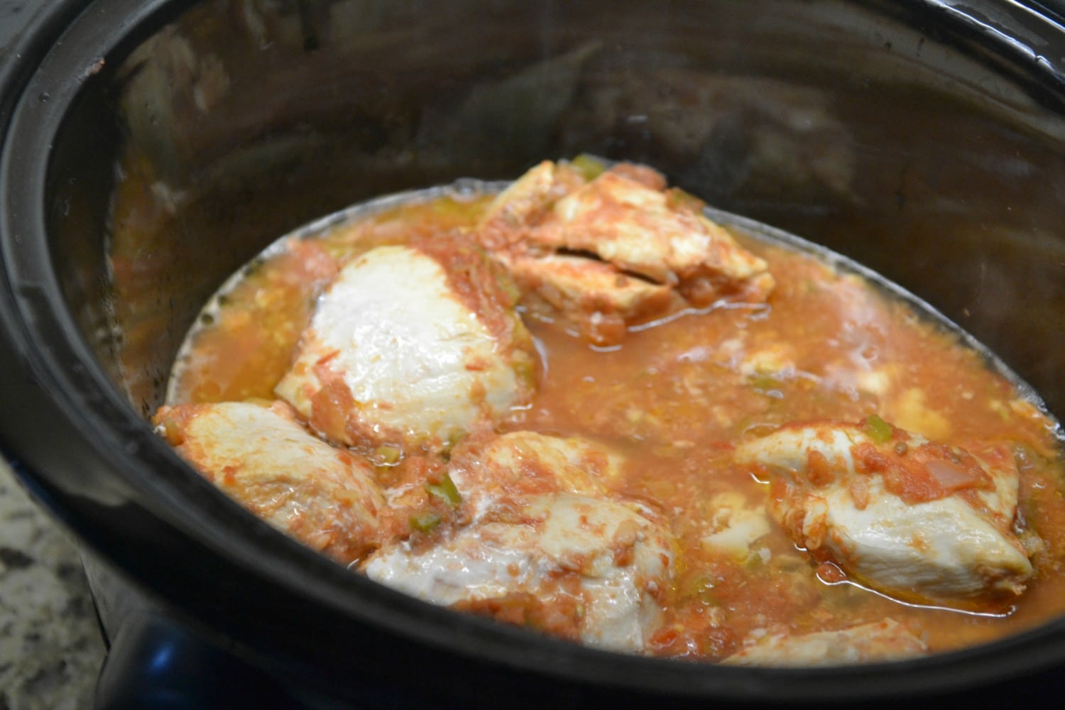 Place chicken and salsa mixture directly into slow cooker.