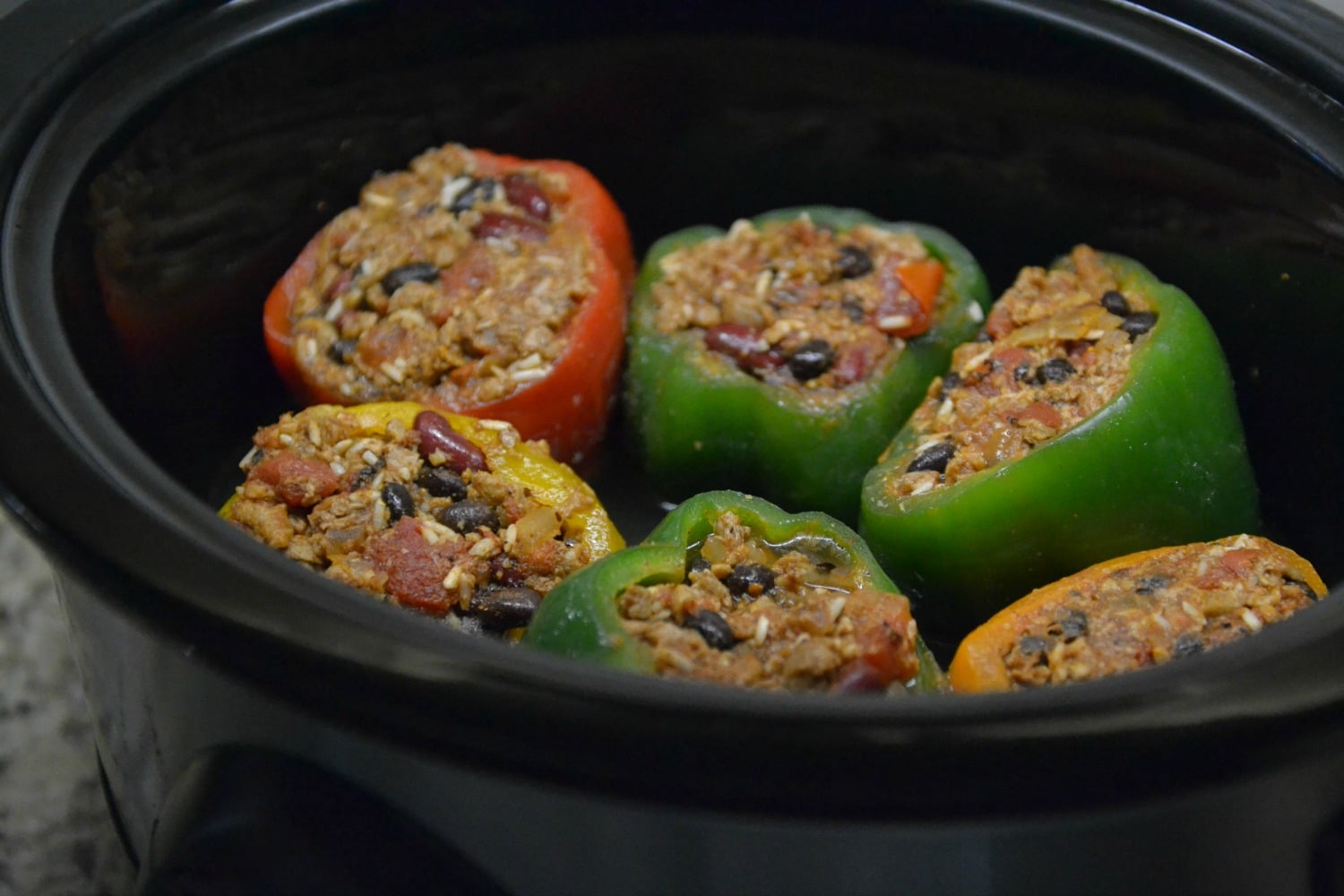Cook stuffed peppers in a crock pot for 3-4 hours, until the peppers are tender.