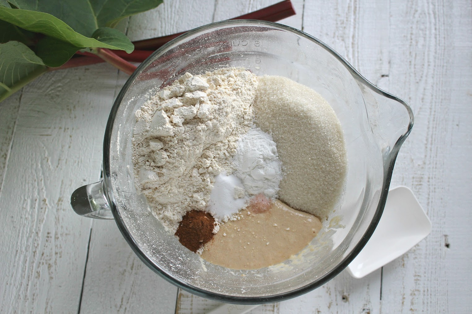 Add the dry ingredients - flour, sugar, baking powder, baking soda, cinnamon, and salt - to the batter and mix until combined.