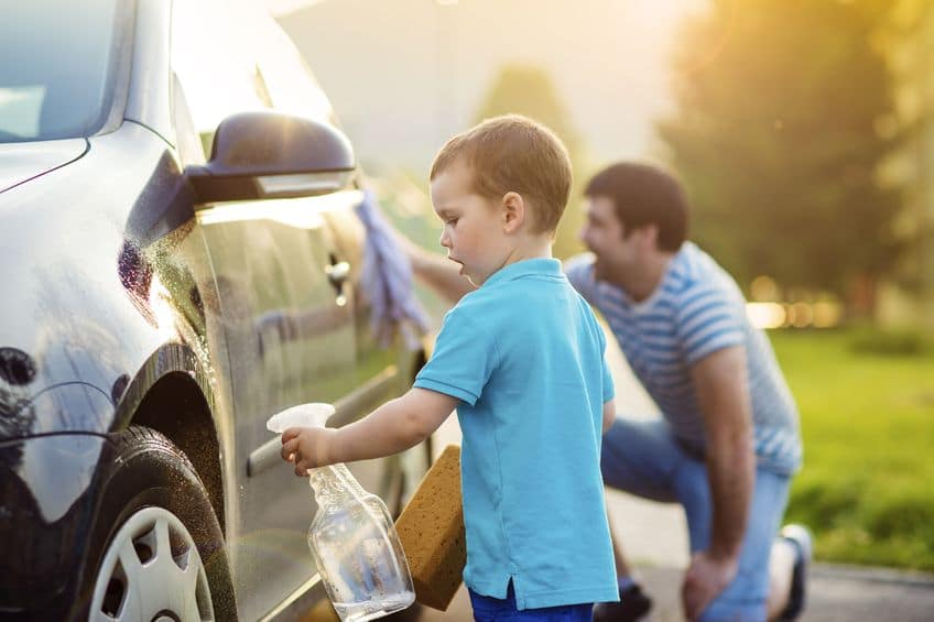Give your kids confidence by letting them assist with activities like cleaning the car.