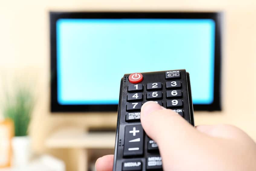 A television remote pointed at a TV screen.