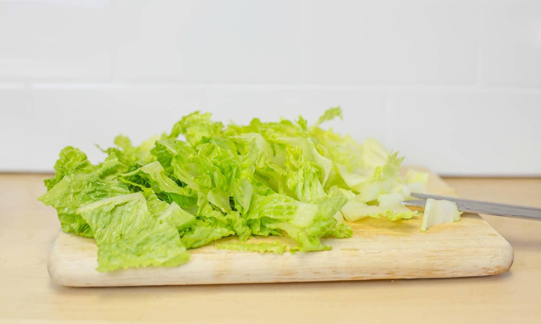 Chop lettuce and set aside.