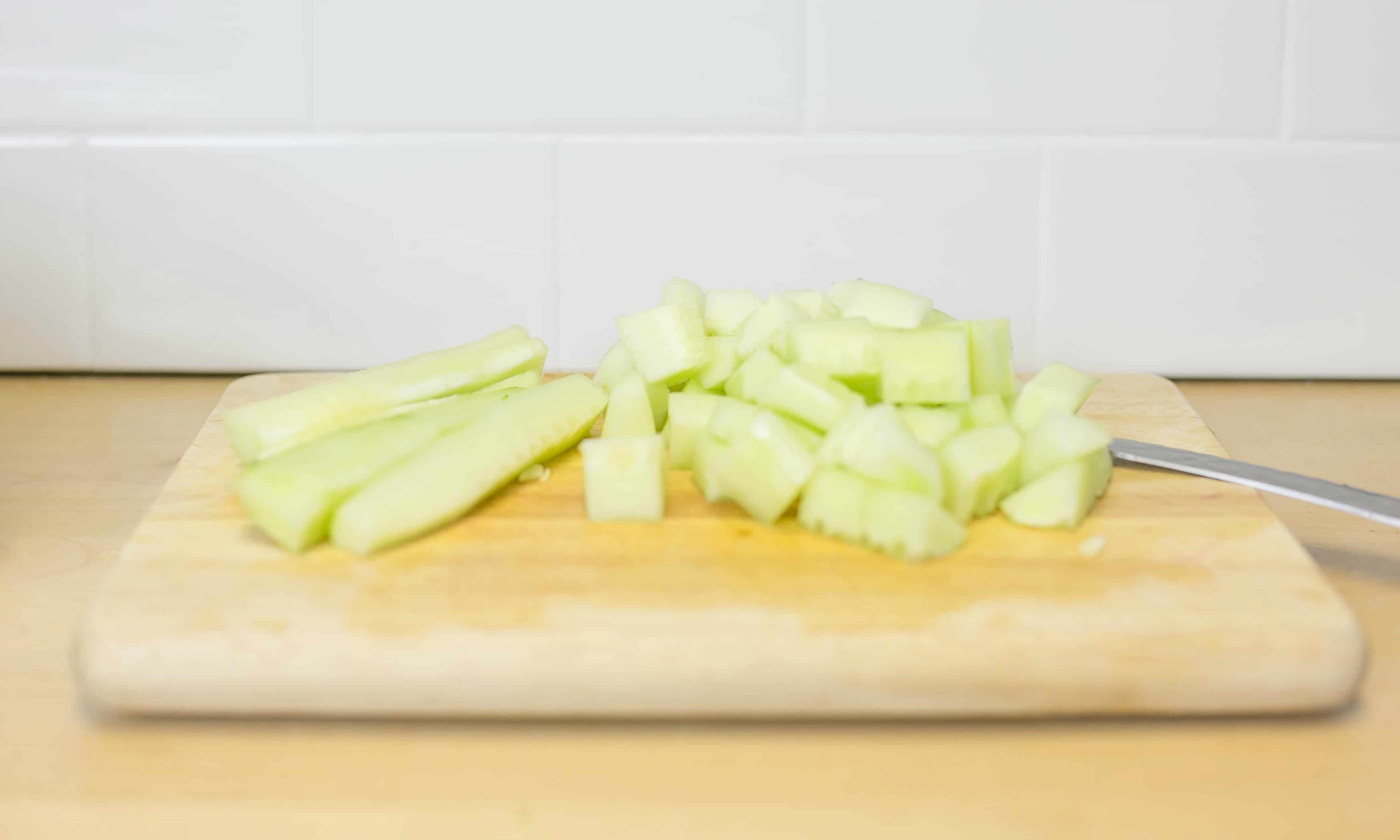 Peel cucumber, seed it and chop then set aside.