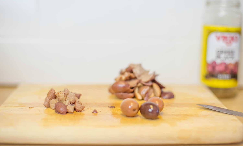 Then pit olives, chop and set aside.