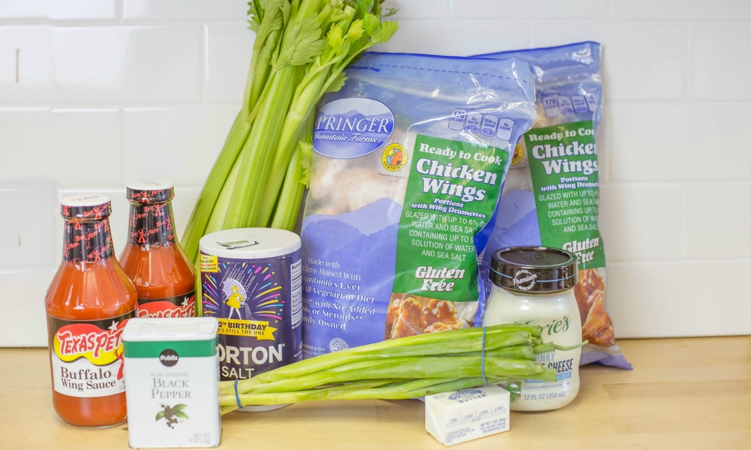 To make freezer to crock pot buffalo wings you need: chicken wings, celery, buffalo sauce, salt, pepper, butter and blue cheese dressing.