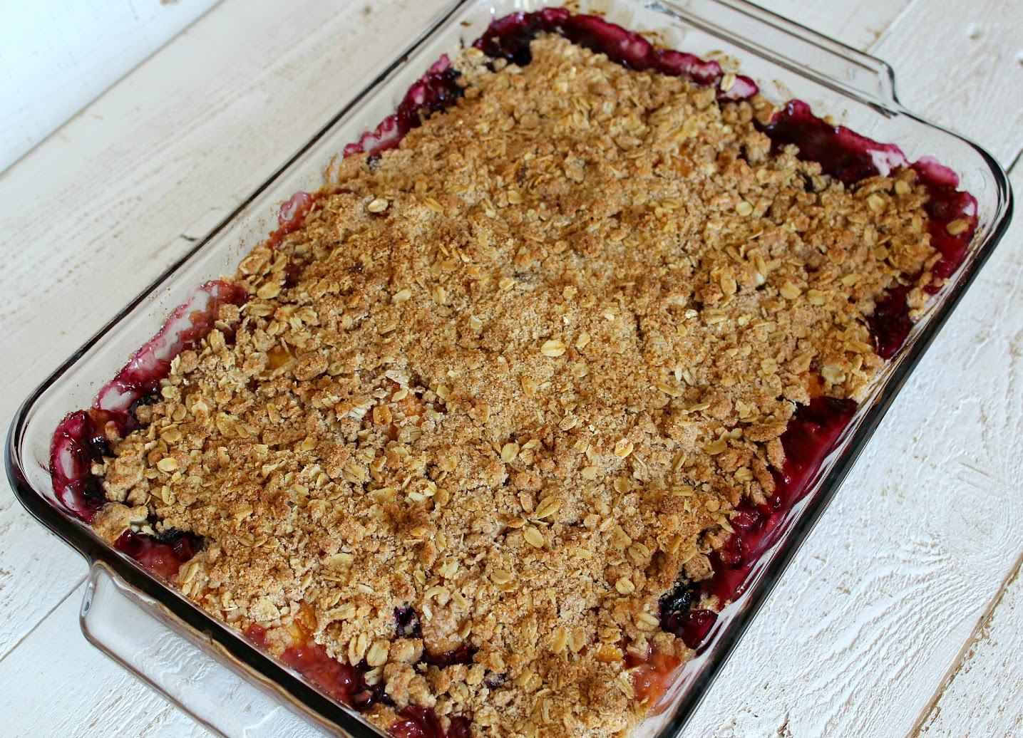 Bake the blueberry peach crumble until the top is browned and the fruit is bubbling.