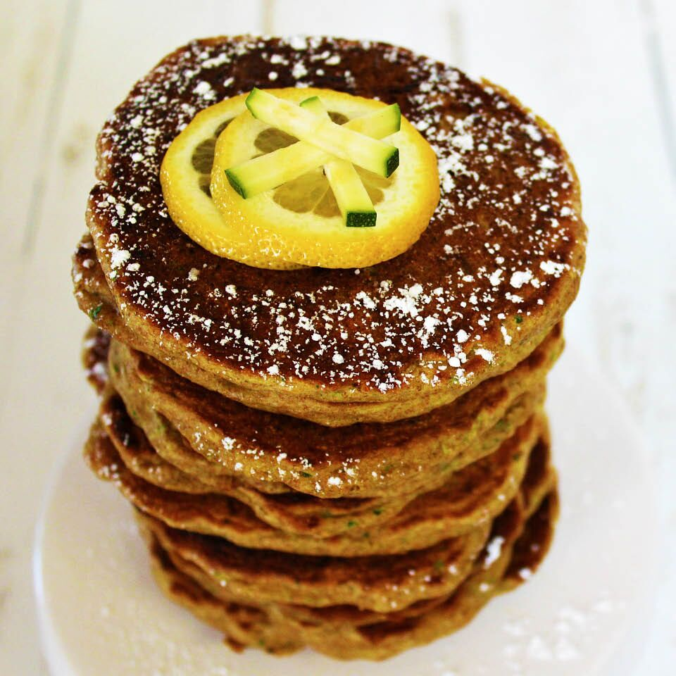 These lemon zucchini pancakes are fluffy and dusted with powdered sugar.
