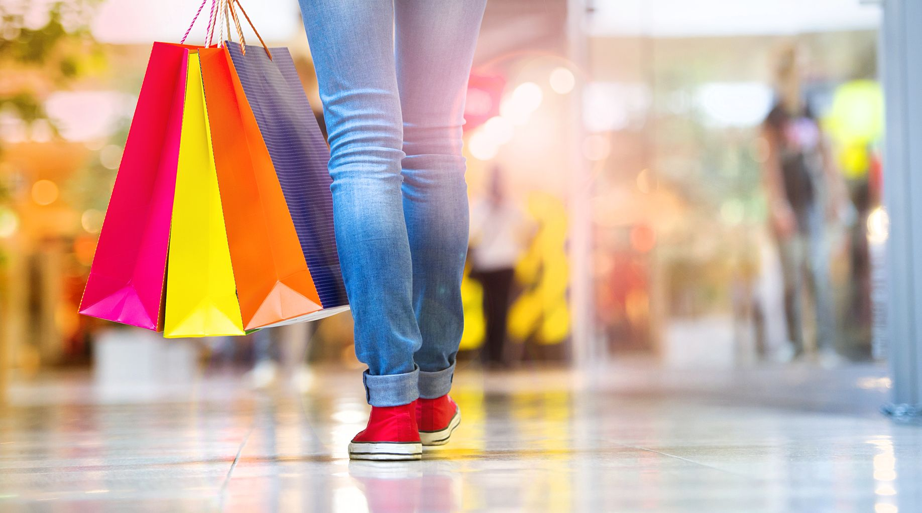 30498633 - shopping time, closeup of teenage girl legs with shopping bags at shopping mall
