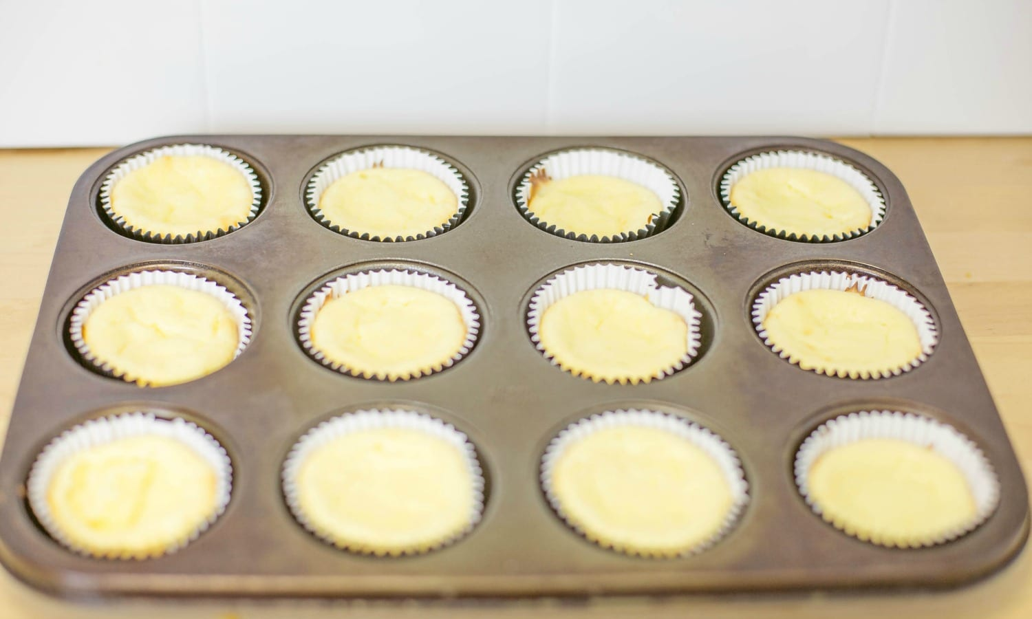 Almost done! Bake for 20 minutes and then cool these amazing-smelling, easy Mini Cheesecakes.