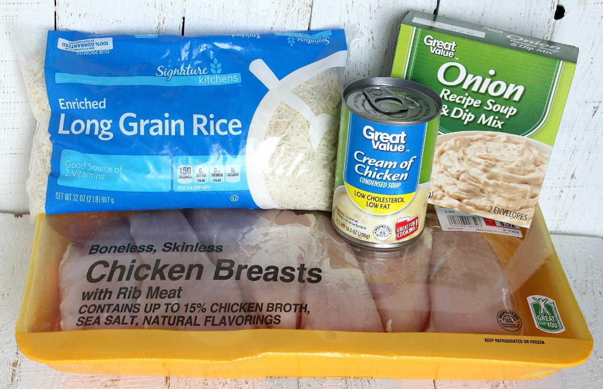 The simple ingredients for this rice and chicken bake: rice, chicken breasts, cream of chicken soup and onion dip mix.