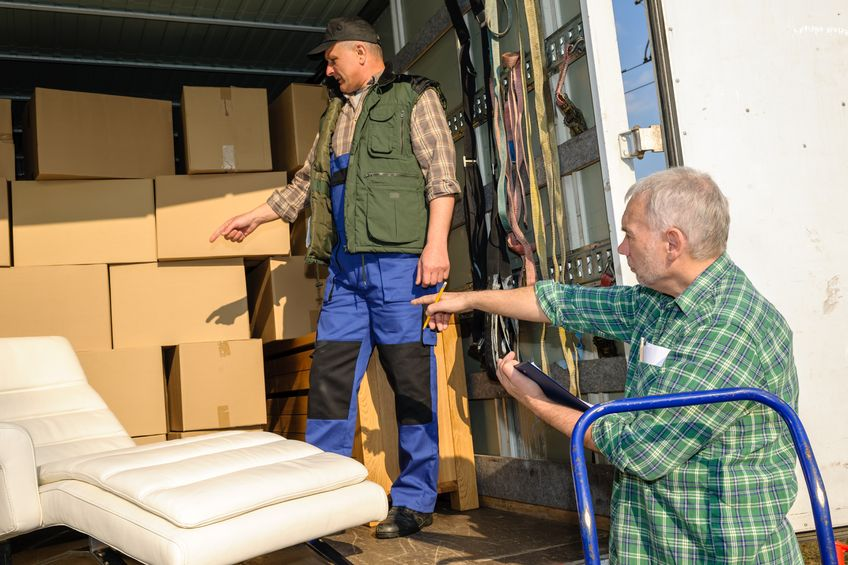 13321450 - two male movers unload furniture and boxes from moving truck