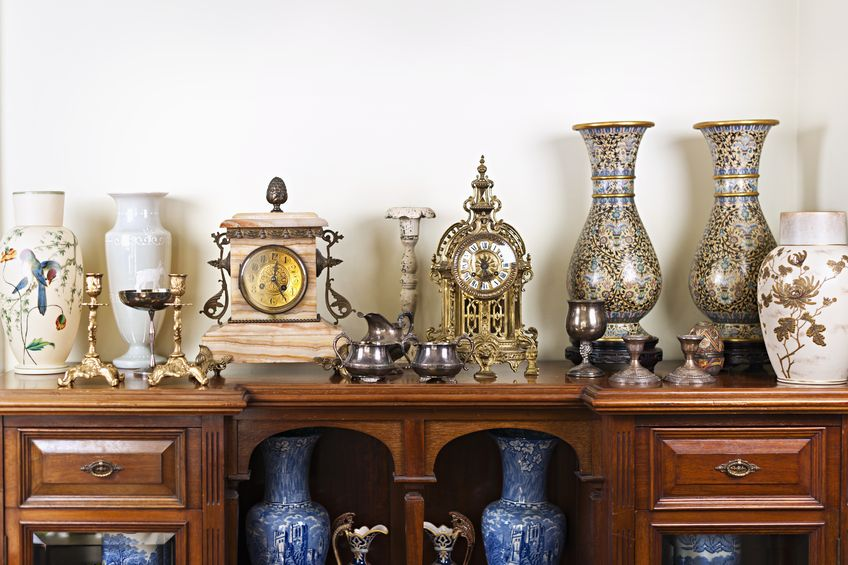 19014571 - various antique clocks vases and candlesticks on display