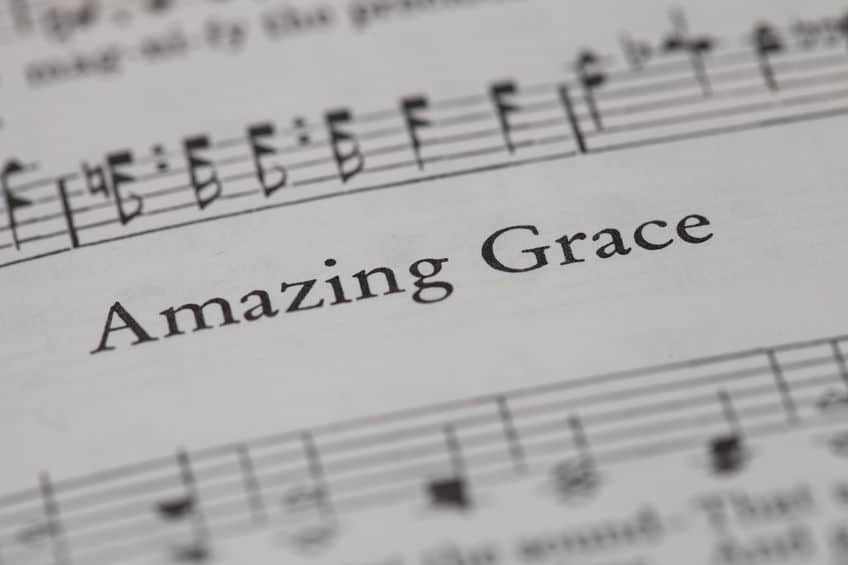 "45564430 - chiangmai, thailand, april 21,2015. singing the christian hymnal book on the song of "" amazing grace "" at home. april 21,2015"