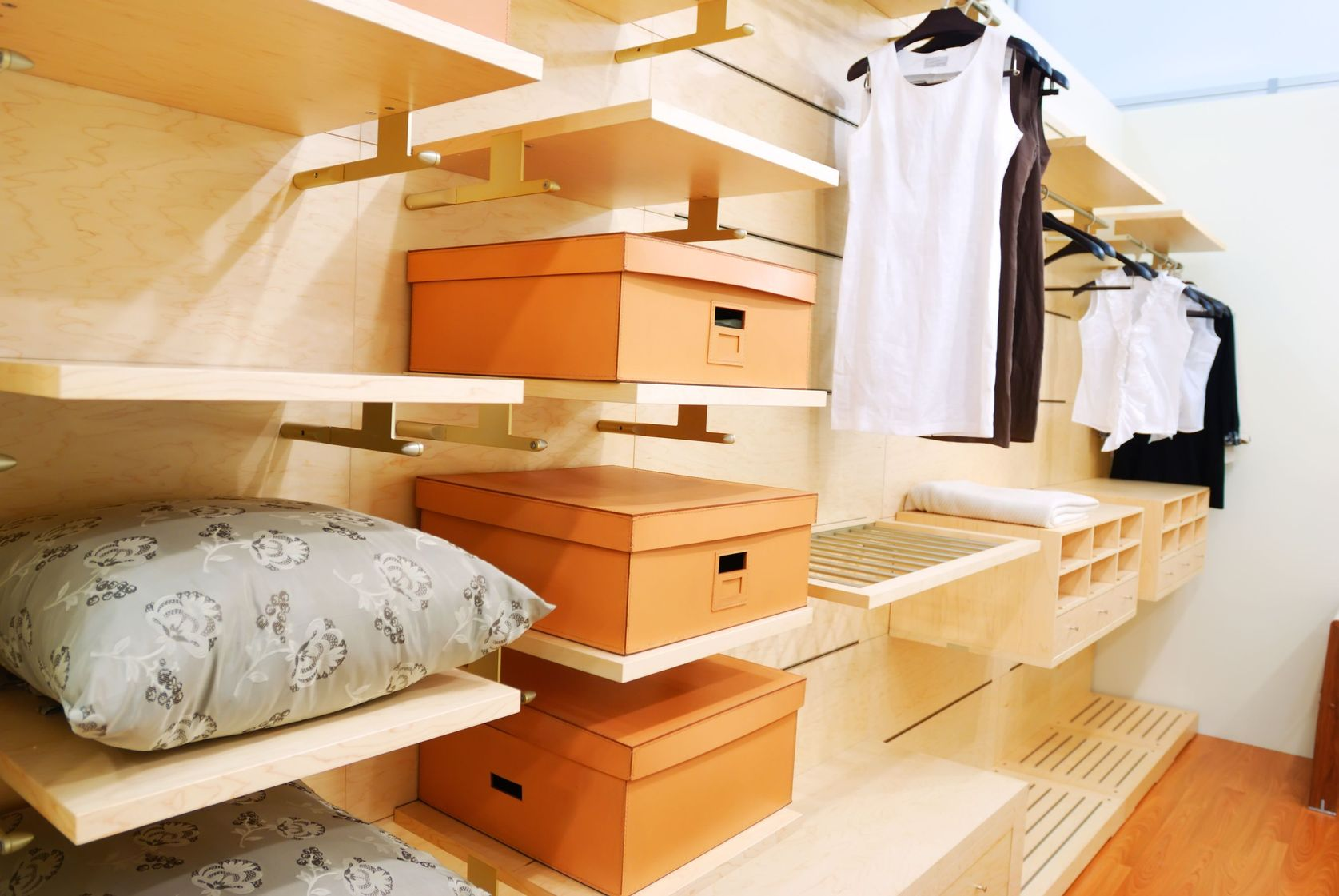 This organized closet is tidy and has lots of storage.