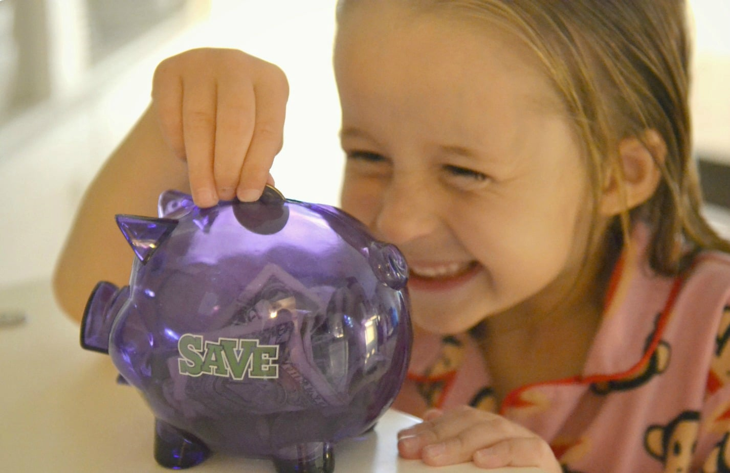 Teach kids how to get excited about saving money!