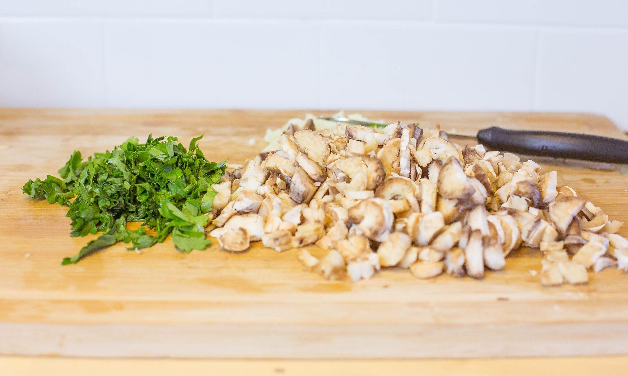 Chop garlic, parsley, and mushrooms.