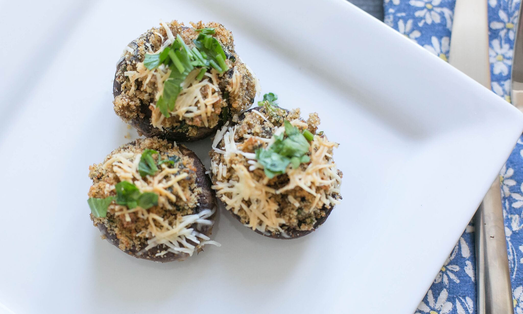 Serve these easy stuffed mushrooms garnished with parsley and fresh parmesan cheese.