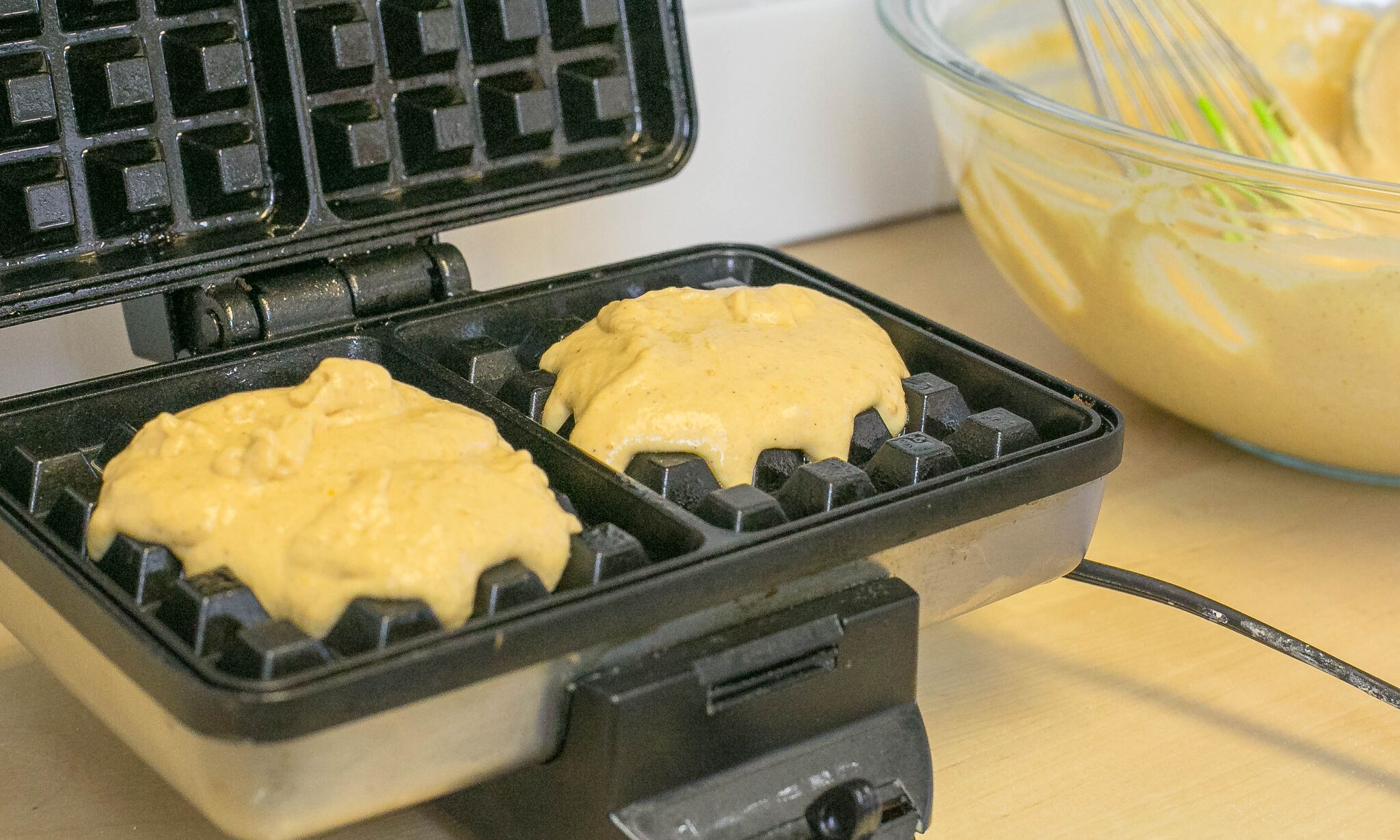 Add one ladle full of batter into waffle iron and cook till lightly brown and crisp.