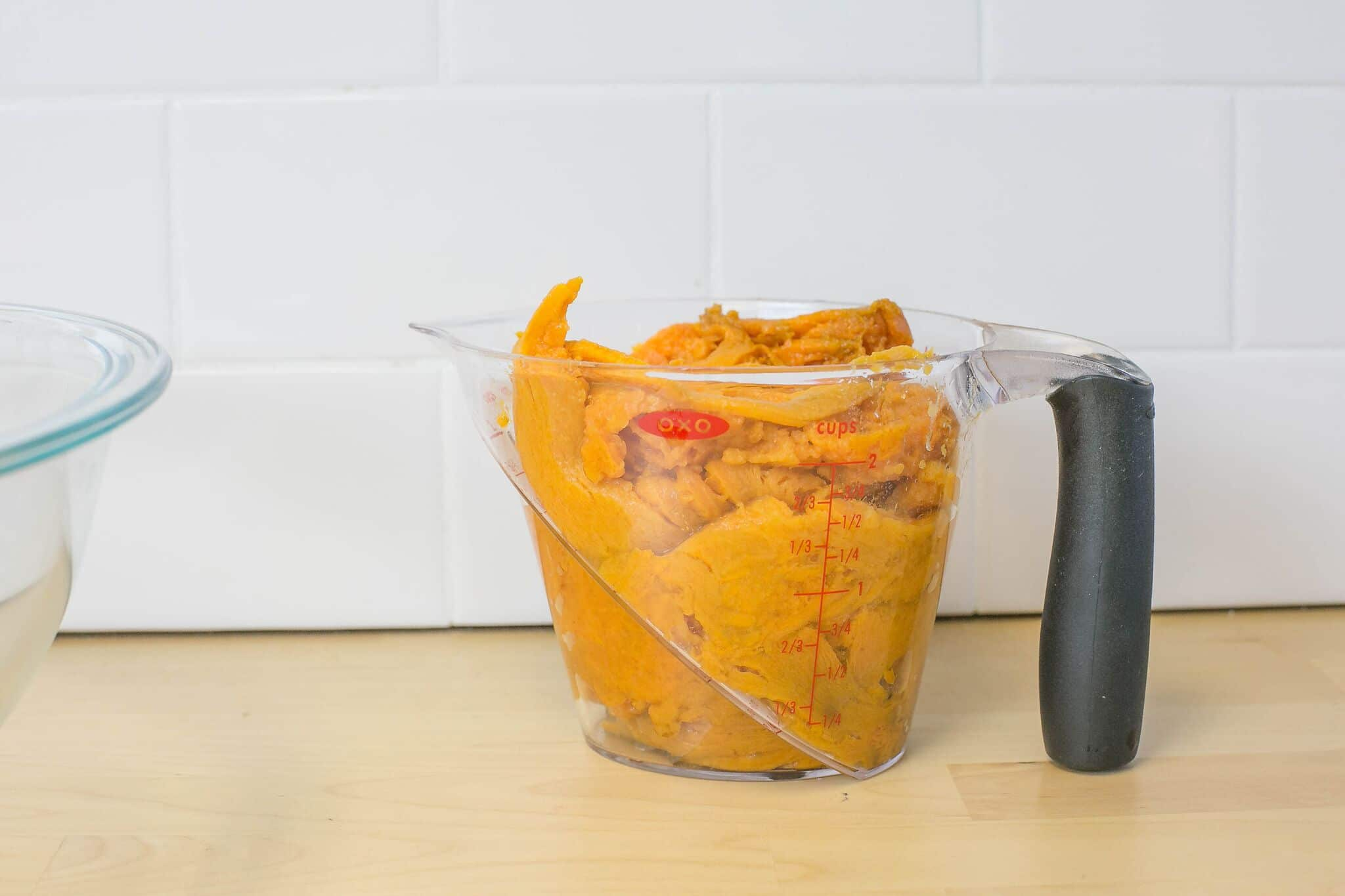 Placed cooled, mashed sweet potatoes into large measuring cup.