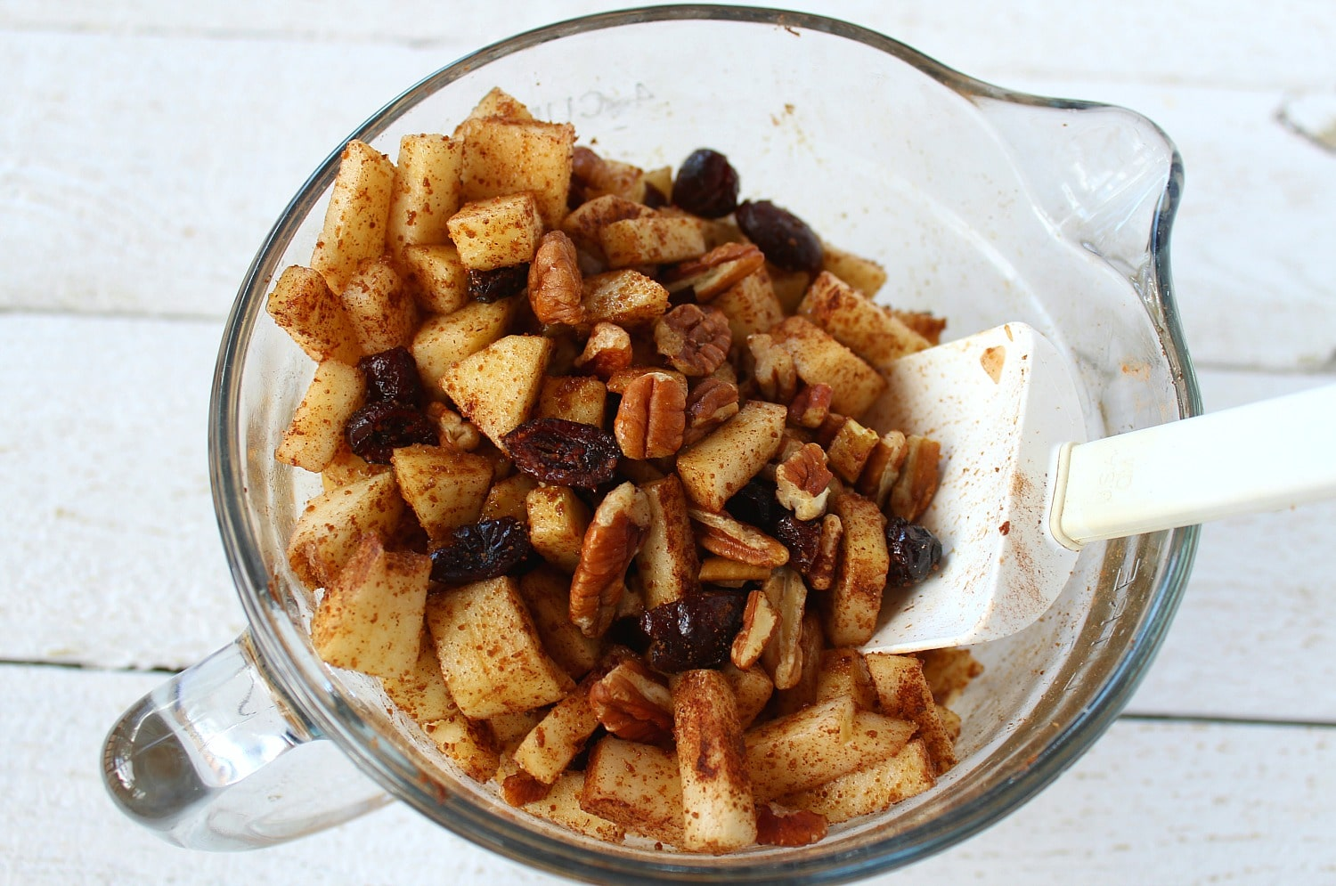 Combine diced apples, chopped pecans, dried cranberries, coconut sugar, salt and cinnamon in a medium sized bowl.
