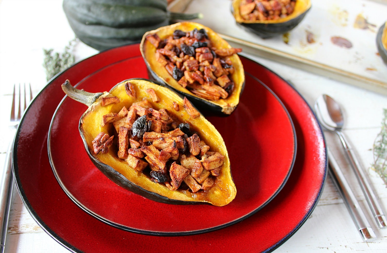 Serve baked stuffed acorn squash on plate.