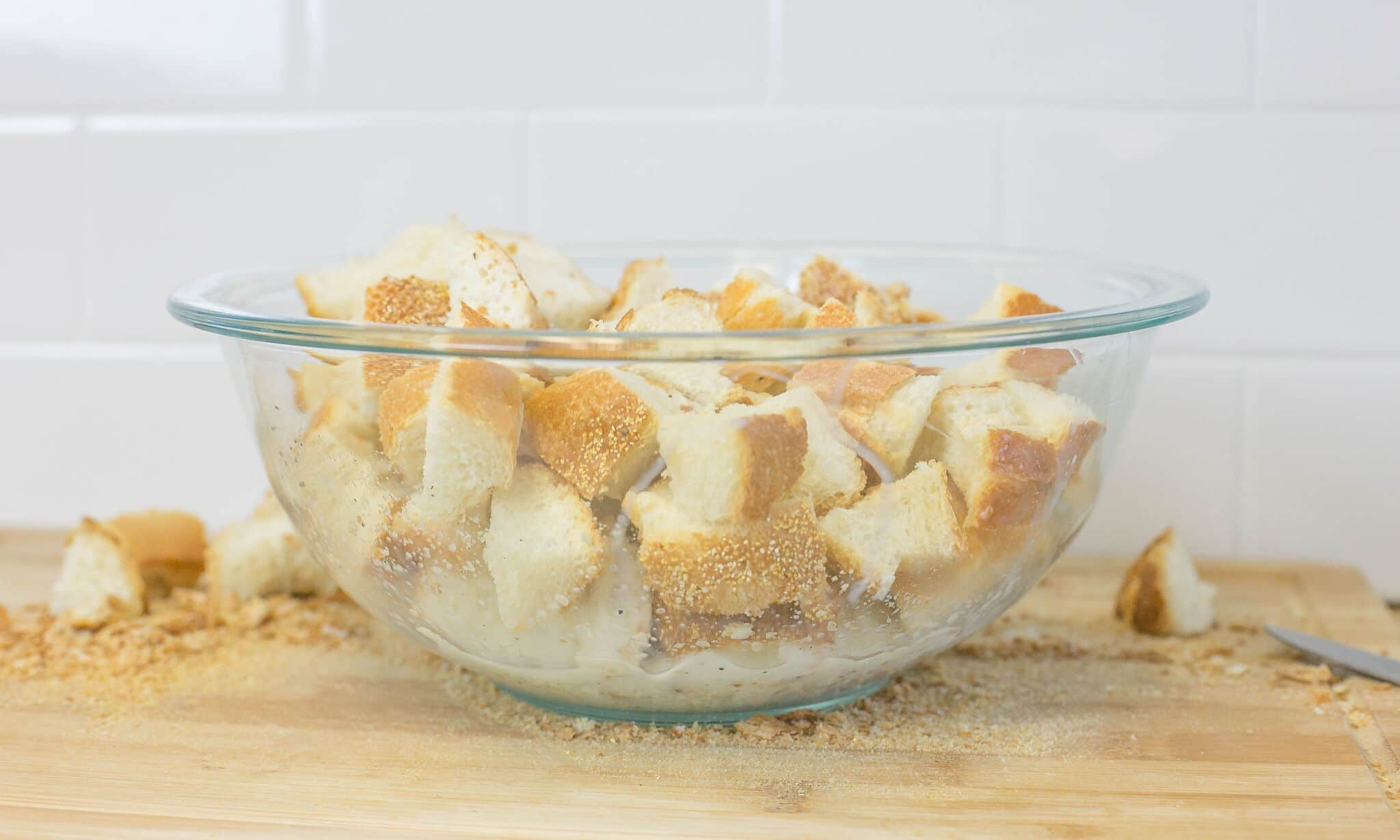 Cube bread; and add to bowl of milk seasoned with salt and pepper.