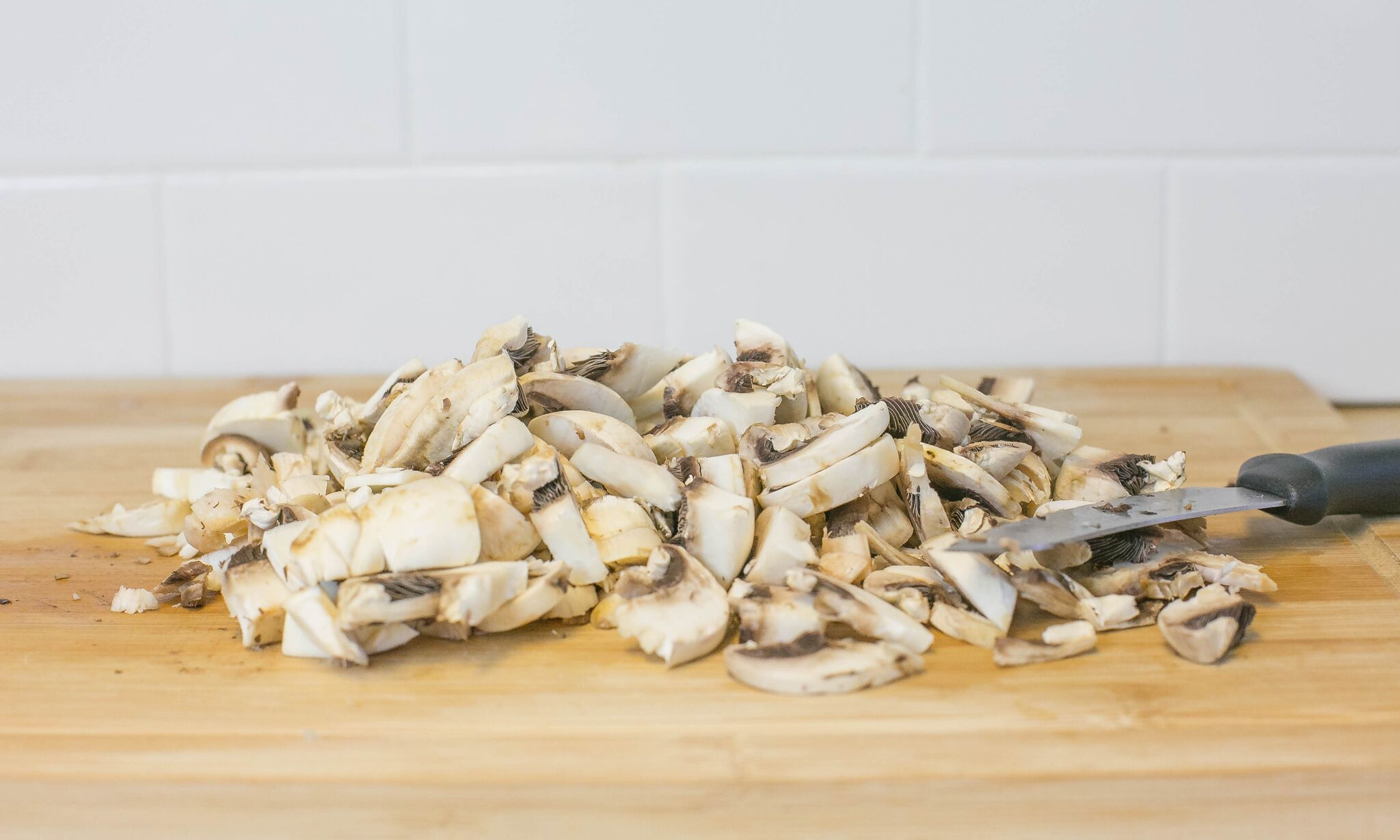 Clean and chop mushrooms and set aside.