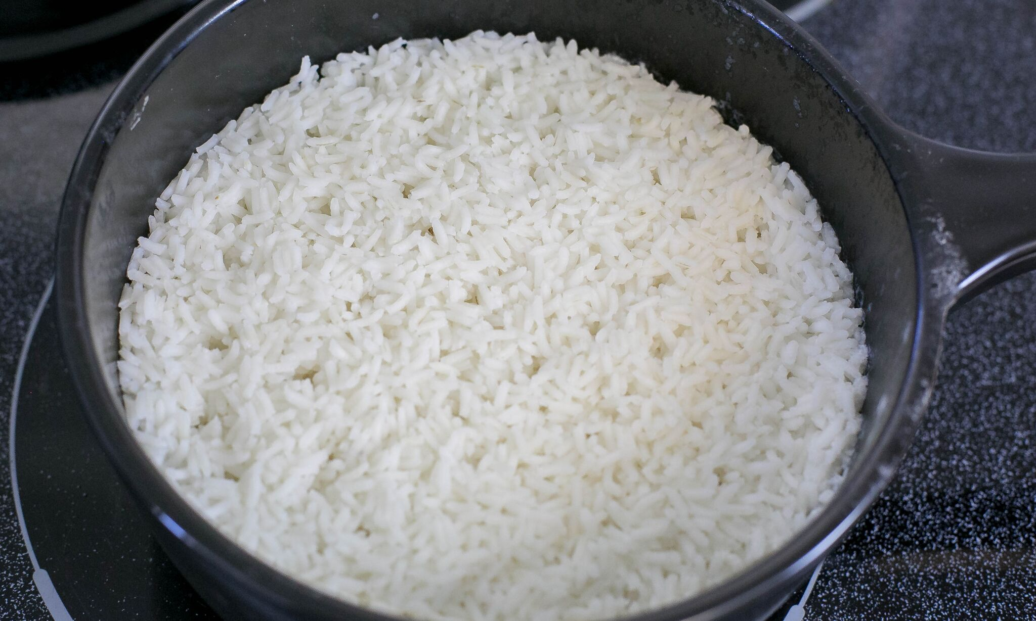 Cook rice on stove according to package directions.